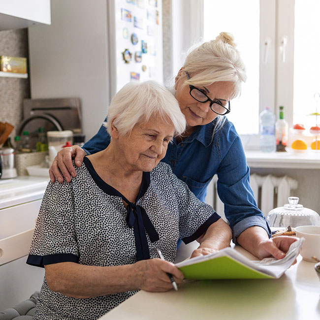 Woman caring for elderly woman